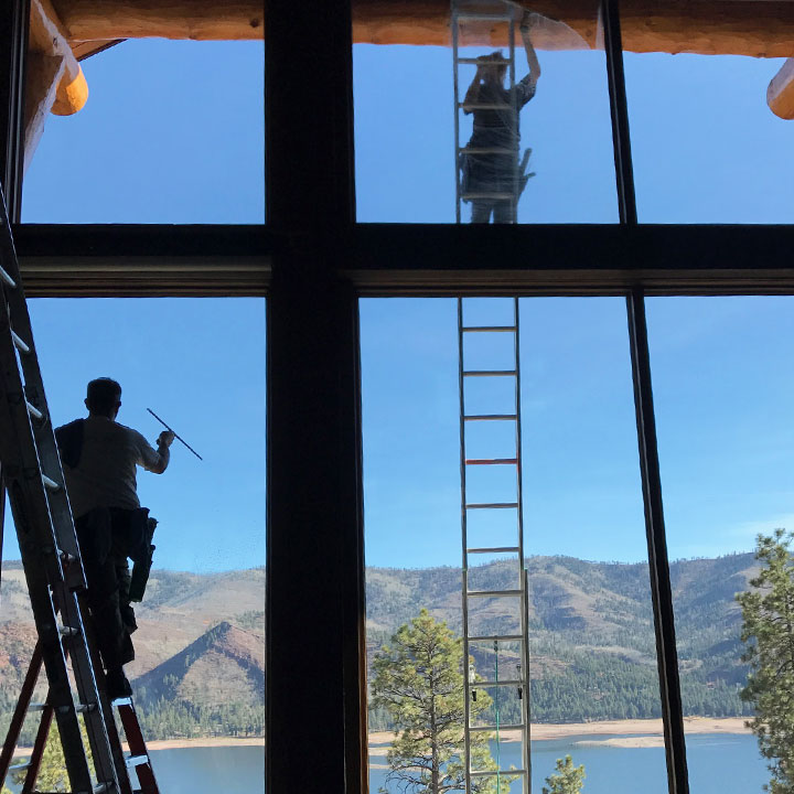 cleaning a window in durango
